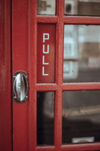 Red telephone box handle, photo from https://stocksnap.io